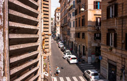 ROME STREET VIEW FROM WINDOW WITH SHUTTER Stock Photo