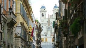 Rome, summer 2016. The church of Trinita dei Monti at the Spanish Steps (Piazza di Spagna). View from Via dei Condotti, main shopping street in Rome stock video footage
