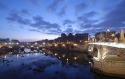 Rome before sunrise. Bridge Sant'Angelo and bridge Vittorio Emanuele II, wide angle view just before sunrise. Rome, Italy Stock Photos