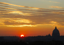 Rome at sunset. The suggestive colors of a sunset panorama with the Saint Peter Basilica silhouette, Rome, Italy Royalty Free Stock Photography