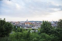 Rome at sunset seen from the hill. Rome, the capital of Italy, at sunset seen from the hill royalty free stock photo