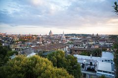 Rome at sunset seen from the hill. Rome, the capital of Italy, at sunset seen from the hill stock photo