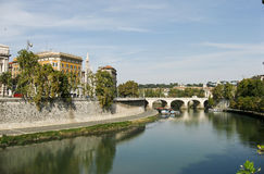 Rome Tevere River. A bridge with arches and the historical buildings at the shore of the Tevere River, Rome, Italy Royalty Free Stock Image