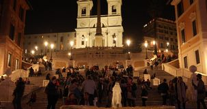 Rome, Trinità dei Monti church, spanish steps and Spain square 4k real video. In the night stock footage