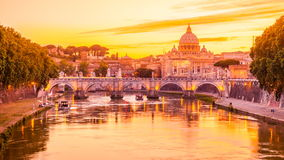 Rome at twilight. Time lapse in 4K of Cityscape of Rome at twilight to night. with San Pietro cathedral, Sant'Angelo bridge and Tiber river illuminated by city stock video footage
