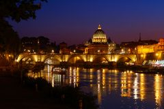Rome twilight view St. Peter dome, Tiber river and St. Angel bridge. Rome twilight view of St. Peter dome Tiber river and St. Angel bridge royalty free stock photos