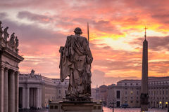 Rome Vatican city. Sunrise over the St. Peters Basilica in Vatican City. Morning at the most famous landmark, empty of people street, cloudy sky Stock Photo