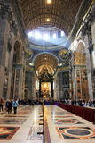 Rome Vatican, Italy - Saint Peter basilica. Saint Peters basilica interior - Vatican in Rome, Italy, indoor, religious peligrins and tourists visiting the Stock Image