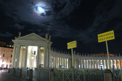 Rome Vatican June 2016. St. Peters crowd night entrance with sign to holy door. Porta Santa only opens during a Jubilee year for the pilgrims to pass royalty free stock photo