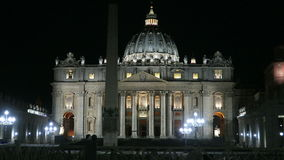 Rome, Vatican summer 2016. Facade of St. Peter's Basilica at night. The Papal Basilica view in Italy, Rome from empty St. Peter's square at midnight stock video