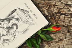 Romeo and Juliet. Open book and red rose stock photo