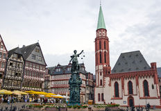 Romerberg, Frankfurt, Germany. View of the historical center of Frankfurt Altstadt, Romerberg plaza, Fountain of Justice and Old Saint Nicholas Church Royalty Free Stock Photos