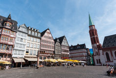 Romerberg square  in  Frankfurt, Germany. Frankfurt, Germany - August 26 2015: Famous historical landmark  of  Romerberg square with people around at the city of Stock Photos