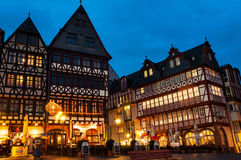 Romerberg square in Munich at night. FRANKFURT, GERMANY - MARCH 21, 2014: Old medieval building at Romerberg square. It is made in middle-age style in Altstadt Stock Photo