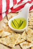 Romero y galletas curruscantes del aceite de oliva en el papel del arte Imagen de archivo libre de regalías