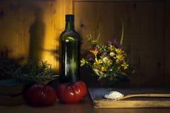 romero y tomates virginales de la harina del aceite de oliva Fotos de archivo libres de regalías