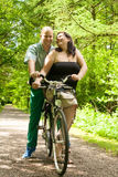 Romnantic couple on a bike Stock Image