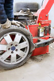 Romoving tyre. Man removes tyre from alu wheel Royalty Free Stock Photos