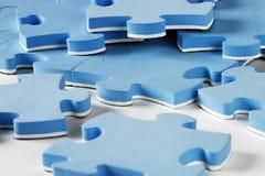 Rompecabezas azules Foto de archivo libre de regalías