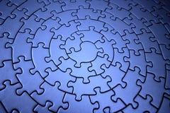Rompecabezas azules tridimensionales Imagenes de archivo