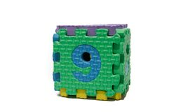 Rompecabezas colorido del cubo de los números impares - nueve Fotografía de archivo