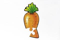 Rompecabezas con la imagen de la zanahoria Imágenes de archivo libres de regalías
