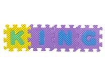Rompecabezas de goma que forma a un rey de la palabra Imágenes de archivo libres de regalías