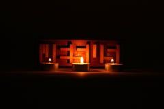 Rompecabezas de Jesús en trinidad de la luz de una vela Fotos de archivo libres de regalías