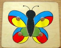 Rompecabezas de la mariposa Imagen de archivo libre de regalías