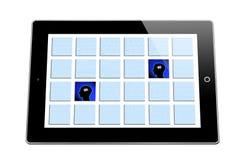 Rompecabezas de la memoria en la tableta Fotos de archivo libres de regalías