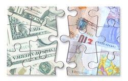 Rompecabezas de la moneda de la libra del dólar Foto de archivo