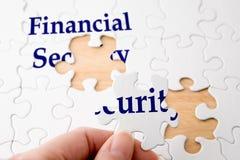 Rompecabezas de la seguridad financiera Fotografía de archivo