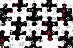 Rompecabezas de las paginaciones y de rompecabezas del calendario Foto de archivo libre de regalías