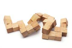 rompecabezas de madera 3D Imagen de archivo libre de regalías