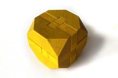 Rompecabezas de madera amarillo Foto de archivo