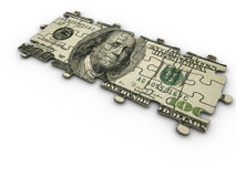 Rompecabezas de rompecabezas del dólar Foto de archivo libre de regalías