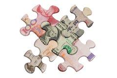 Rompecabezas de rompecabezas y dinero en circulación importante del mundo Fotos de archivo libres de regalías