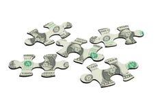 Rompecabezas de rompecabezas y nota de dólar americano Foto de archivo libre de regalías