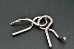 Rompecabezas del alambre (anillo del rompecabezas) Fotos de archivo