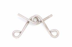 Rompecabezas del alambre (anillo del rompecabezas) Imagen de archivo libre de regalías