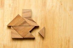 Rompecabezas del rompecabezas chino en la forma casera con el pedazo que falta Fotografía de archivo libre de regalías