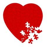 Rompecabezas del corazón quebrado aislado en blanco Imagen de archivo libre de regalías
