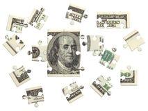 Rompecabezas del dólar dispersado Fotos de archivo