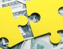 Rompecabezas del dinero Imagenes de archivo