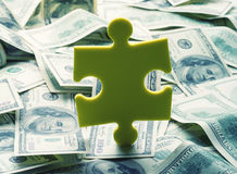 Rompecabezas del dinero Foto de archivo libre de regalías