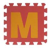Rompecabezas del texto de M en el fondo blanco, EVA Foam que entrelaza, Clipp Imagen de archivo libre de regalías