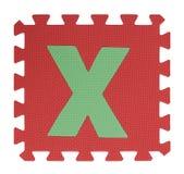 Rompecabezas del texto x en el fondo blanco, EVA Foam que entrelaza, Clipp Foto de archivo