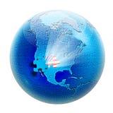 Rompecabezas en el globo con el indicador los E.E.U.U. adentro Imagen de archivo libre de regalías