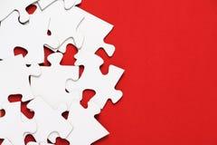 Rompecabezas en rojo Imágenes de archivo libres de regalías