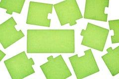 Rompecabezas en un fondo blanco Foto de archivo libre de regalías